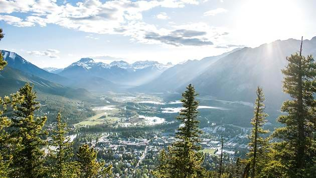 banff-town-mountains-aerial-view3-joshua-reddekopp-c02km2q1wek-unsplash_1280x720_for_navi_web